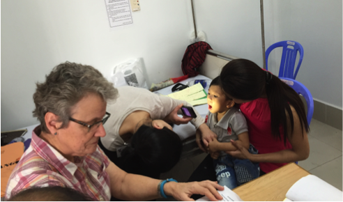 Dr June Wu and Kristin Stueber  team up to examine patients on clinic day